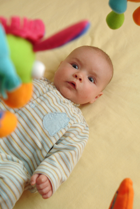 How Crib Toys and Baby Mobiles Affect Your Baby's Sleep