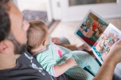 Dad reading a story to a baby